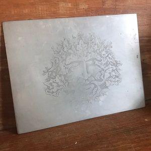 Etched metal leaf man art